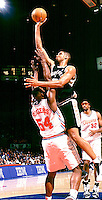 San Antonio Spurs SuperStar Tim Duncan shoots over Clippers Rodney Rogers.