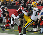 Green Bay Packers receiver James Jones is pushed out of the end zone by  Atlanta Falcons safety Thomas DeCoud during the fourth quarter of the game at the Georgia Dome in Atlanta, Ga., on Nov. 28, 2010.