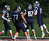 Max Napoli #11 of Northport, right, gets congratulated by teammates after scoring on a 26-yard touchdown in the second quarter of a Suffolk County Division I varsity football game against Patchogue-Medford at Half Hollow Hills East High School in Dix Hills on Sunday, Oct. 1, 2017. Northport won by a score of 35-19.