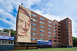 """Students living in McCabe Hall enjoy apartment and suite-style living. All units include a bathroom and living room, and apartments include a full kitchen. August 8, 2013. The building features the """"We Are DePaul"""" mural of St. Vincent de Paul.(DePaul University/Jeff Carrion)"""