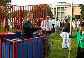 Washington, DC - June 25, 2009 -- White House Press Secretary Robert Gibbs reaches for a towel after being knocked into a dunk tank by members of the news media before a luau for members of Congress and their families on the South Lawn of the White House June 25, 2009 in Washington, DC. In a celebration of U.S. President Barak Obama's home state, the South Lawn was decorated with tiki torches and palm huts and the meal prepared by famous Hawaiian chef Alan Wong..Credit: Chip Somodevilla - Pool via CNP