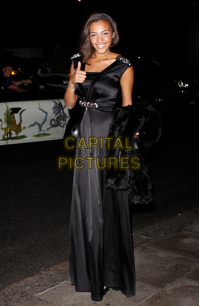 Amal Fashanu.The Fashion for the Brave fundraising event inn aid of the British Forces Foundation & the Household Cavalry Operational Casualties Fund, Dorchester Hotel, London, England..September 20th, 2012.full length black sleeveless dress silk satin.CAP/AH.©Adam Houghton/Capital Pictures.