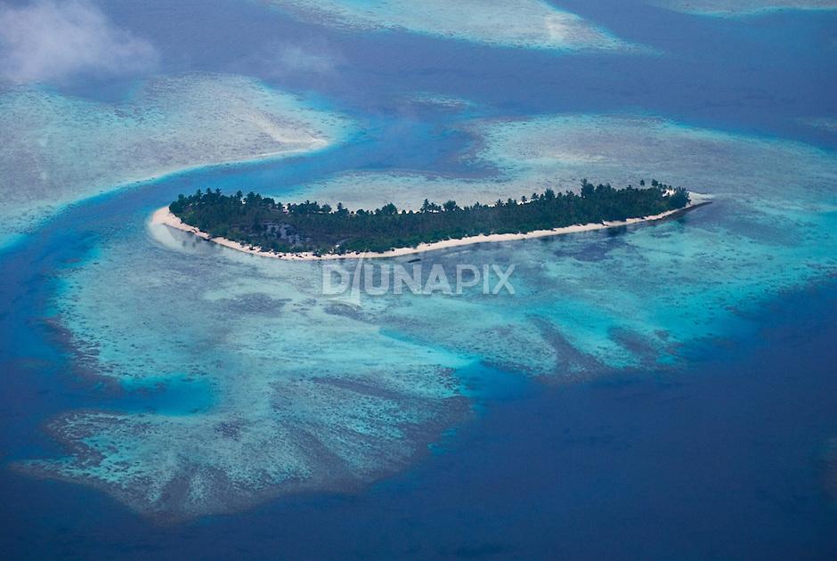 A small reefy island near Waghena (west of the Arnavons).