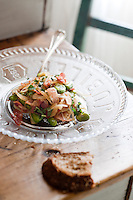 Close up of a salad of broad beans and bacon prepared by chef Maddalena Caruso and served on a glass plate commemorating Queen Victoria's Jubilee