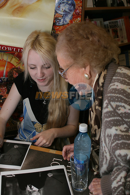 Lily Tormey gets book signed by  Evanna Lynch who plays Luna Lovegood in Harry Potter and the Order of the Phoenix. ..Photo NEWSFILE/Jenny Matthews.(Photo credit should read Jenny Matthews/NEWSFILE)....This Picture has been sent you under the condtions enclosed by:.Newsfile Ltd..The Studio,.Millmount Abbey,.Drogheda,.Co Meath..Ireland..Tel: +353(0)41-9871240.Fax: +353(0)41-9871260.GSM: +353(0)86-2500958.email: pictures@newsfile.ie.www.newsfile.ie.FTP: 193.120.102.198.