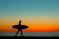 March 2, 2017 - San Diego, California, USA -  A surfer walks with his board as the sun sets at Windansea Beach in the La Jolla community of San Diego, California. (Photo Credit: © K.C. ALFRED/ZUMA PRESS)