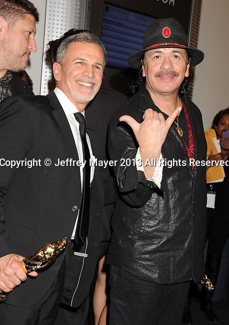 PASADENA, CA- SEPTEMBER 27: Actor Tony Plana (L) and musician Carlos Santana pose in the press room at the 2013 NCLA ALMA Awards at Pasadena Civic Auditorium on September 27, 2013 in Pasadena, California.