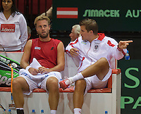 13-sept.-2013,Netherlands, Groningen,  Martini Plaza, Tennis, DavisCup Netherlands-Austria, First Rubber,   Oliver Marach (AUT)  on the bench with Captain Clemens Trimmel<br /> Photo: Henk Koster