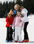Princess Beatrix of The Netherlands (C top) pose with her granddaughters Princess Catharina-Amalia (R), Princess Alexia (L), Princess Ariane pose at a photocall during their ski holidays, in Lech am Arlberg on February 23, 2015. PIERRE TEYSSOT