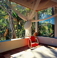 The bedroom looks out to dense vegetation surrounding this guest house in Verana.