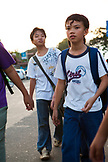 PHILIPPINES, Palawan, Puerto Princesa, young boys walk in the street in Central Puerto Princesa near the Mitra Amphitheater