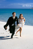 Australia, Queensland, couple running on beach.  MR available