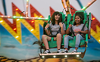 NWA Democrat-Gazette/BEN GOFF @NWABENGOFF<br /> Visitors enjoy the midway carnival rides and games Saturday, Aug. 12, 2017, on the final day of the Benton County Fair in Bentonville.