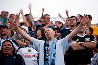 A Philadelphia Union fan cheers at the end of a Major League Soccer game at PPL Park in Chester, PA.  Philadelphia defeated New York, 3-0.