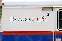 "Great phrase ""It's about life"" on side of truck in parking lot. Aquatennial Beach Bash Minneapolis Minnesota USA"