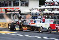 Aug. 5, 2011; Kent, WA, USA; NHRA top fuel dragster driver Troy Buff during qualifying for the Northwest Nationals at Pacific Raceways. Mandatory Credit: Mark J. Rebilas-