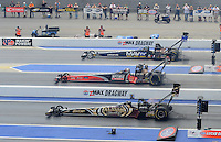 Apr. 15, 2012; Concord, NC, USA: NHRA top fuel dragster drivers (top to bottom) Brandon Bernstein , David Grubnic and Khalid Albalooshi race side by side by side during the Four Wide Nationals at zMax Dragway. Mandatory Credit: Mark J. Rebilas-