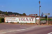 Road crossing in Meursault, signs indicating the wine route (route de vin) towards Volnay