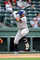 Right fielder Yonathan Daza (2) of the Asheville Tourists bats in a game against the Greenville Drive on Friday, April 24, 2015, at Fluor Field at the West End in Greenville, South Carolina. Greenville won, 5-2. (Tom Priddy/Four Seam Images)