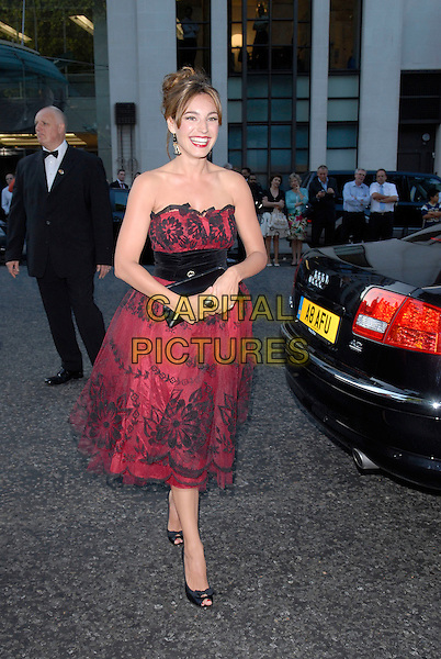 KELLY BROOK.Arrivals at the 4th Annual Glamour Women Of The Year Awards, Berkely Square Gardens, London, England. .June 5th 2007.full length red strapless dress black lace net netting fifties style prom shoes peep-toe bow waistband clutch purse.CAP/FIN.©Steve Finn/Capital Pictures