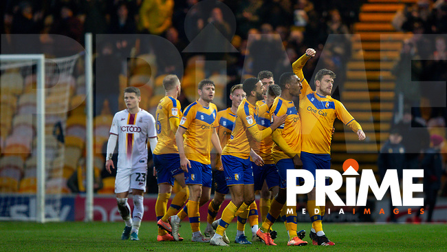 Andy Cook of Mansfield is congratulated by his team mates after making it 3-0 during the Sky Bet League 2 match between Mansfield Town and Bradford City at the One Call Stadium, Mansfield, England on 25 January 2020. Photo by Thomas Gadd.