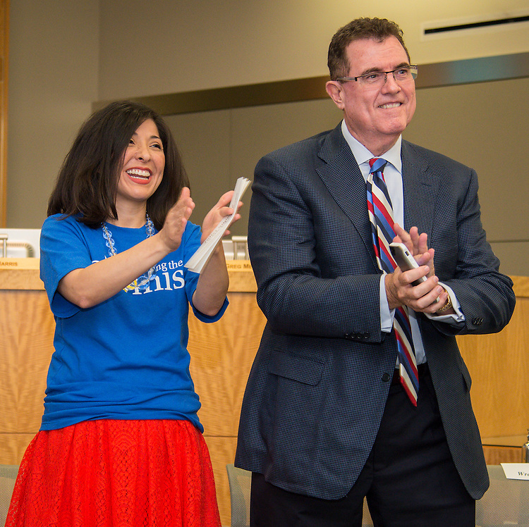Houston ISD board of trustees president Juliet Stipeche, left, and superintendent Dr. Terry Grier, right, react during ceremony recognizing the District's employee anti-bullying policy, September 12, 2014.