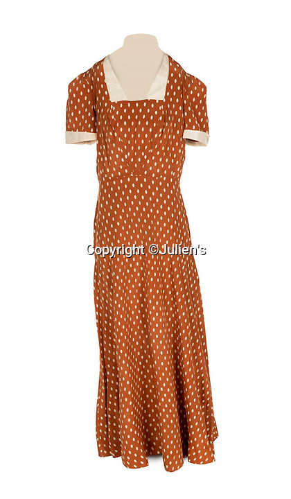 """BNPS.co.uk (01202 558833)<br /> Pic:  Julien's/BNPS<br /> <br /> A custom made silk dress with ivory dots worn by Mae West in 1940, est. £800.<br /> <br /> A selection of trailblazing 1930s starlet Mae West's most recognisable film costumes have emerged for sale for £320,000. ($400,000)<br /> <br /> The auction features the actress and screenwriter's gowns, headdresses and tiaras, as well as props from her films and her scripts.<br /> <br /> West, a New York native, was the Marilyn Monroe of her era, earning a 'bad girl' reputation for starring in risque productions.<br /> <br /> She famously coined the phrase: """"When I'm good, I'm very good, but when I'm bad, I'm better."""""""