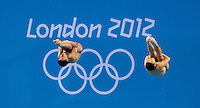 30 JUL 2012 - LONDON, GBR - Cao Yuan (CHN) and Zhang Yangquan (CHN) of China on their way to winning the Mens 10m Synchronised Diving at the London 2012 Olympic Games event in the Aquatics Centre in the Olympic Park, Stratford, London, Great Britain .(PHOTO (C) 2012 NIGEL FARROW)