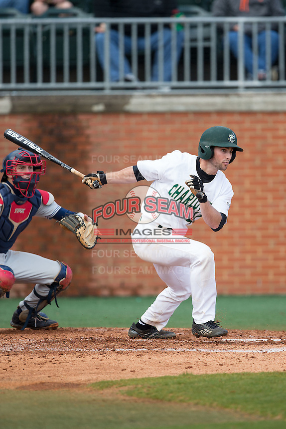Derek Gallello (41) of the Charlotte 49ers follows through on his swing against the Florida Atlantic Owls at Hayes Stadium on March 14, 2015 in Charlotte, North Carolina.  The Owls defeated the 49ers 8-3 in game one of a double header.  (Brian Westerholt/Four Seam Images)