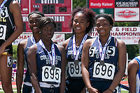 Collegiate School of Medicine and Bioscience's team of (left to right) Nature Williams-Harkins, Janise Lemon, Latricia Book, and Tiffany Lomax stand on the awards podium after their runner-up finish in the Class 2 4x100 in 51.20 at the Missouri Class 1 and 2 State Track and Field Championships in Jefferson City, Saturday, May 21.