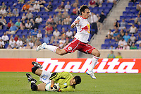 Marcos Paullo (32) of the New York Red Bulls jumps over FC New York goalkeeper Steven Diaz (13). The New York Red Bulls defeated FC New York 2-1 during a third round match of the 2011 Lamar Hunt US Open Cup at Red Bull Arena in Harrison, NJ, on June 28, 2011.
