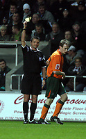 ATTENTION SPORTS PICTURE DESK<br /> Pictured: David Gray of Plymouth (R) sees a yellow card from referee I G Williamson (L)<br /> Re: Coca Cola Championship, Swansea City FC v Plymouth Argyle at the Liberty Stadium, Swansea, south Wales. 10 March 2009.<br /> Picture by D Legakis Photography / Athena Picture Agency, Swansea 07815441513