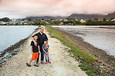 USA, Oahu, Hawaii, Jujitsu martial arts fighter Keith Chang with his son and daughter at the Kaneohe fish pond
