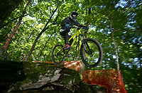 NWA Democrat-Gazette/BEN GOFF @NWABENGOFF<br /> Riders take practice runs on the downhill course on Friday July 15, 2016 at the 18th annual Fat Tire Festival at Lake Leatherwood City Park in Eureka Springs. Short track races were held Friday evening, the downhill and super-d races will begin Saturday morning, and cross country races will take place on Sunday.
