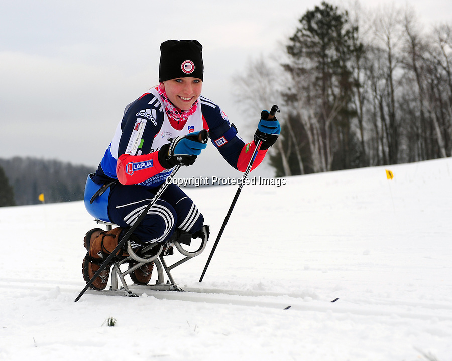 Kristina Vaughn of Team USA competes in the ski-sit sprint during the 2013 International Paralympic Committee's Nordic Skiing World Cup in Cable, WI.