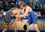 BROOKINGS, SD - NOVEMBER 17: Gregory Coapstick from South Dakota State University battles with Nick Piccininni from Oklahoma State University during their 125 pound match Saturday night at Frost Arena in Brookings. (Photo by Dave Eggen/Inertia)
