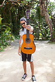 JAMAICA, Port Antonio. Portrait of local with his guitar at Frenchman's Cove Resort.