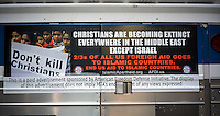 An advertisement on a NYCTA bus in New York on Thursday, October 9, 2014 promotes stopping U.S. aid to Islamic countries. The controversial advertisements are from the American Freedom Defense Initiative, a group run by Pamela Geller who also runs the Stop Islamization of America group. (© Richard B. Levine)