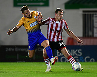 Lincoln City's Harry Toffolo crosses the ball despite the attentions of Mansfield Town's Alex MacDonald<br /> <br /> Photographer Chris Vaughan/CameraSport<br /> <br /> The EFL Checkatrade Trophy Group H - Lincoln City v Mansfield Town - Tuesday September 4th 2018 - Sincil Bank - Lincoln<br />  <br /> World Copyright © 2018 CameraSport. All rights reserved. 43 Linden Ave. Countesthorpe. Leicester. England. LE8 5PG - Tel: +44 (0) 116 277 4147 - admin@camerasport.com - www.camerasport.com
