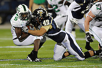 14 November 2009:  FIU linebacker Tyler Clawson (49) tackles North Texas running back Lance Dunbar (5) in the first half as the FIU Golden Panthers defeated the North Texas Mean Green, 35-28, at FIU Stadium in Miami, Florida.