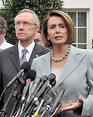 Washington, DC - October 6, 2009 -- United States Speaker of the House Nancy Pelosi makes remarks after meeting United States President Barack Obama on the U.S. strategy in Afghanistan on Tuesday, October 6, 2009.  At left is United States Senate Majority Leader Harry Reid (Democrat of Nevada). .Credit: Ron Sachs / Pool via CNP
