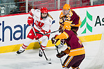 Wisconsin Badgers Kelly Jaminski (7) handles the puck during an NCAA women's hockey game against the Minnesota Golden Gophers on October 14, 2011 in Madison, Wisconsin. The Badgers won 3-2. (Photo by David Stluka)