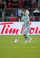 Sporting KC defender/midfielder Luke Sassano #32 in action during an MLS game between Sporting Kansas City and the Toronto FC at BMO Field in Toronto on June 4, 2011..The game ended in a 0-0 draw...