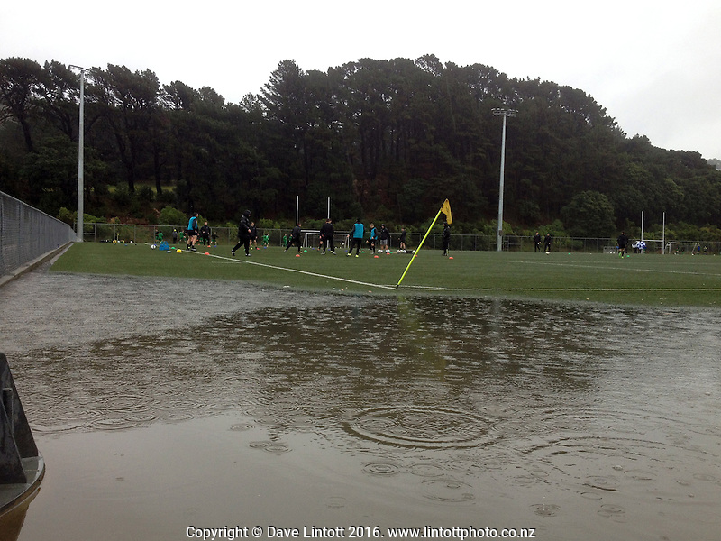 A small lake forms at the edge of the pitch before the Central League football match between Miramar Rangers and Lower Hutt at Wakefield Park, Wellington, New Zealand on Wednesday, 13 August 2016. Photo: Dave Lintott / lintottphoto.co.nz