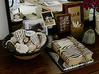 A collection of personal objects is arranged on a side table in Jill's home office