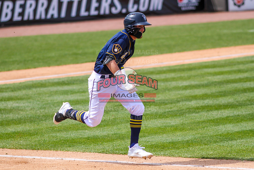 Wisconsin Timber Rattlers second baseman Brice Turang (2) runs to first base during a Midwest League game against the Burlington Bees on April 28, 2019 at Fox Cities Stadium in Appleton, Wisconsin. Wisconsin defeated Burlington 5-4. (Brad Krause/Four Seam Images)
