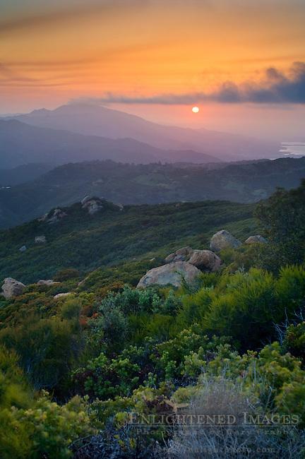 Sunset over Santa Ynez Peak, and the distant Lake Cachuma, from the Santa Ynez Mountains, near Santa Barbara, California