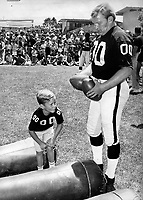 """Raider center Jim Otto with his son Jim Jr. during .""""Family Day""""at the Santa Rosa training site..(1971 photo/Ron Riesterer)"""