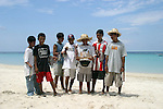 These young boys were busy selling their trinkets to visitors on Roatan's West Bay Beach.