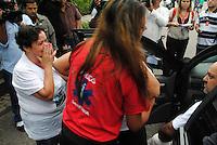 PETROPOLIS, RJ, 25 MARCO 2013 - Mãe de vítima com filho cadeirante é impedida de entrar na missa pela seguranças da presidência na Catedral São Pedro de Alcântara em Petrópolis (RJ), para uma missa em homenagem as vítimas de deslizamentos de terra. FOTO: NICSON OLIVER / BRAZIL PHOTO PRESS).